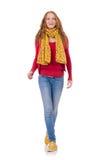 Fille de sourire mignonne dans la veste rouge et des jeans d'isolement Photos libres de droits