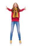Fille de sourire mignonne dans la veste rouge et des jeans d'isolement Photo stock