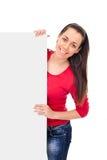 Fille de sourire retenant le panneau blanc Images stock