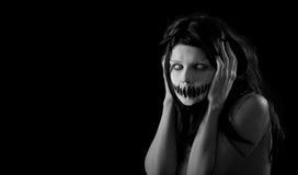 Fille de Veille de la toussaint avec la bouche effrayante Images libres de droits