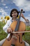 Fille de violoncelle Photos stock