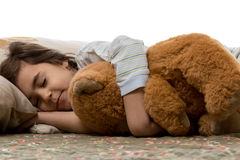 Fille dormant avec l'ours de nounours Photo stock
