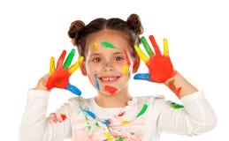 Fille drôle avec les mains et le visage complètement de la peinture Photographie stock