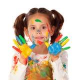 Fille drôle avec les mains et le visage complètement de la peinture Images libres de droits