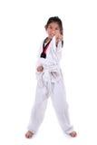 Fille du Taekwondo d'Asiatique dessus avec le fond Photos stock