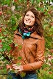 Fille en automne Photos stock