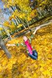 Fille en automne Photographie stock