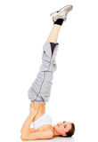 Fille en bonne santé faisant une pose de yoga Photo stock