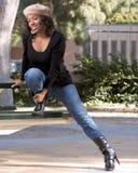 Fille en jeans et gaines Photo libre de droits