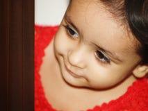 Fille en rouge Photographie stock libre de droits