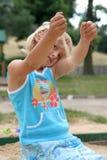 Fille en sable Photo stock