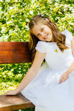 Fille en son premier jour de communion Photographie stock libre de droits