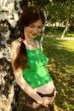 Fille enceinte Photos libres de droits