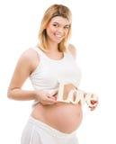 Fille enceinte avec amour de mot Photo libre de droits