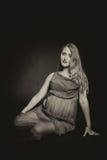 Fille enceinte avec des fleurs Photographie stock