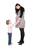 Fille enceinte avec la petite fille Image stock