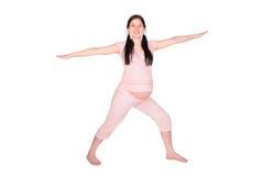 Fille enceinte faisant l'exercice images libres de droits