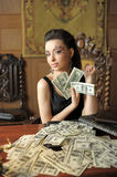 Fille et beaucoup de dollars Photos stock