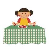 Fille et cerises La petite fille mignonne s'assied à une table et tient des baies illustration libre de droits