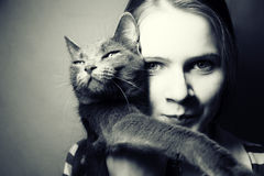 Fille et chat Photo stock