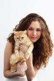 Fille et chat britannique Photos stock