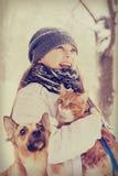 Fille et chat et chien Photographie stock