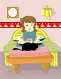 Fille et chat noir Photographie stock