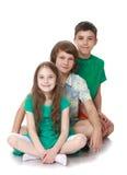 Fille et deux garçons Image stock