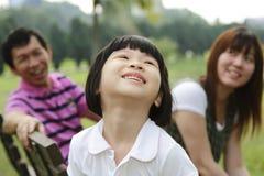 Fille et famille Image stock