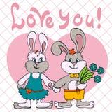 Fille et garçon d'amour de lapins Image libre de droits