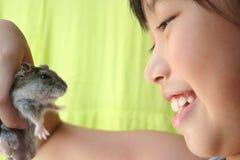 Fille et hamster Images libres de droits