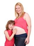 Fille et mère enceinte Photos libres de droits