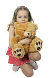 Fille et ours Photo stock