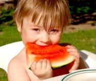 Fille et pastèque Photographie stock