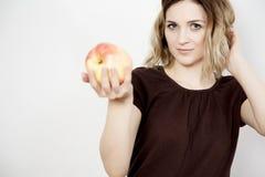 Fille et pomme Photo libre de droits
