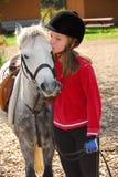Fille et poney Photographie stock libre de droits