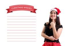 Fille et ses souhaits personnels de Noël Photo stock