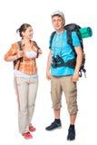 Fille et son ami avec des sacs à dos dans la campagne sur un blanc Images stock
