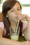 Fille et une boisson Image libre de droits