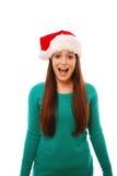 Fille Excited utilisant le chapeau de Santa Image libre de droits