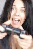 Fille folle de gamer Photographie stock