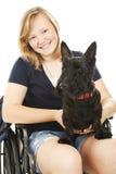 Fille handicapée avec le crabot Photos libres de droits