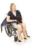 Fille handicapée avec le crabot de Scotty Photo libre de droits