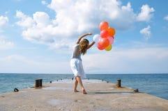 Fille heureuse avec des ballons Photo libre de droits