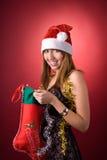 Fille heureuse avec le bas de Noël Images libres de droits