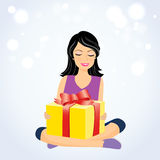 Fille heureuse avec le boîte-cadeau Image stock