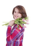 Fille heureuse avec un groupe de tulipes Image stock