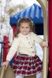 Fille heureuse en stationnement Photographie stock libre de droits
