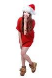 Fille heureuse mignonne de Noël avec le tissu et le chapeau rouges images stock
