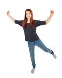 Fille heureuse sautant avec des bras prolongés Image stock